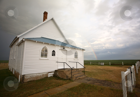 Storm clouds behind a Saskatchewan country church stock photo, Storm clouds behind a Saskatchewan country church by Mark Duffy