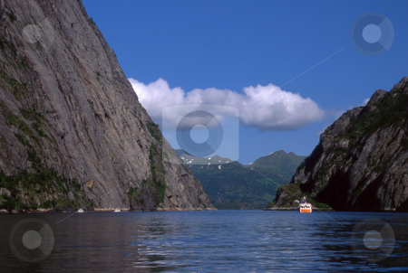 Mountains and sea stock photo, Beautiful Mountains and sea in norway with blue sky by Ingvar Bjork
