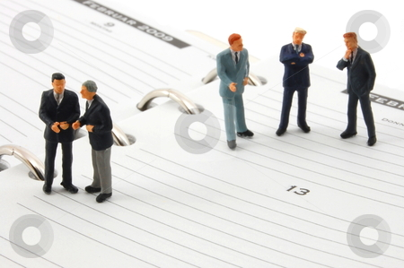Business man on note book stock photo, successful business people on a note book having stress by Gunnar Pippel