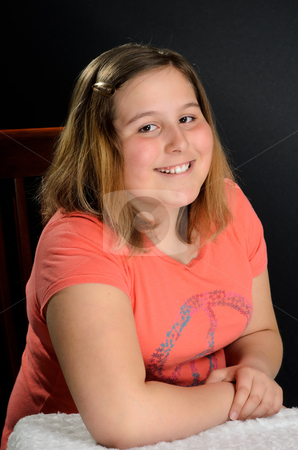 Preteen stock photo, Portait of a happy preteen girl. by Richard Nelson