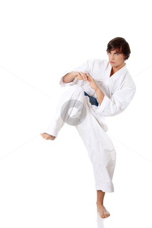 Karate stock photo, Karate. Man in a kimono , isolated on the white background  by Piotr_Marcinski