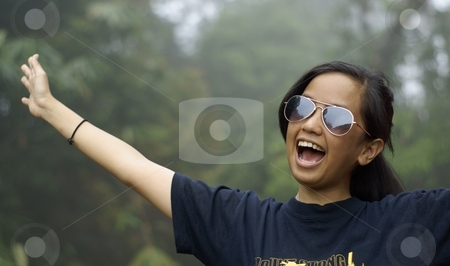 Happy laughing  asian teen girl outdoors stock photo, Happy laughing  asian teen girl outdoors by Wong Chee Yen