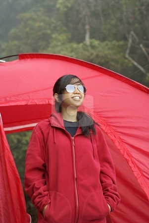 Happy asian girl wearing sunglasses with red tent  stock photo, Happy asian girl wearing sunglasses with red tent outdoors by Wong Chee Yen