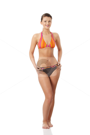 Young beautiful woman in bikini stock photo, Young beautiful woman in bikini, isolated on white background  by Piotr_Marcinski