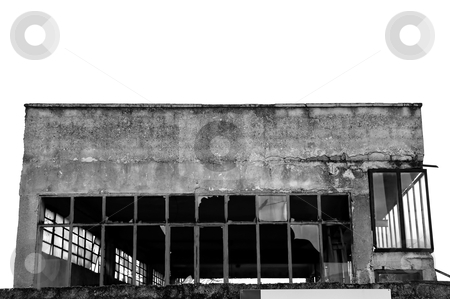 Warehouse stock photo, Broken windows facade of an abandoned warehouse. Black and white. by sirylok