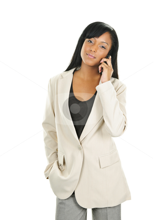 Black young businesswoman on phone stock photo, Young serious black businesswoman on cell phone isolated on white background by Elena Elisseeva
