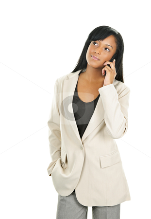 Beautiful young black businesswoman on phone stock photo, Young serious black businesswoman on cell phone looking up by Elena Elisseeva