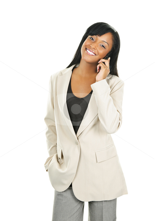 Beautiful black businesswoman on phone stock photo, Young smiling black businesswoman on cell phone isolated on white background by Elena Elisseeva