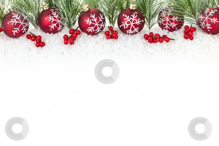 Christmas border with red ornaments stock photo, Christmas border with red ornaments and pine branches by Elena Elisseeva