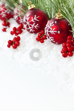 Red Christmas ornaments border stock photo, Red Christmas decorations with pine branches with copy space by Elena Elisseeva