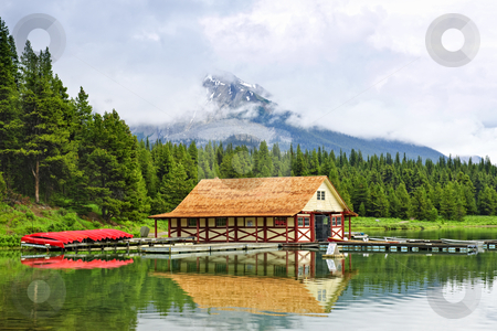 Boathouse on mountain lake stock photo, Canoes at boathouse on Maligne Lake in Jasper National Park, Canada by Elena Elisseeva
