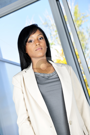 Business woman stock photo, Portrait of black serious business woman in office by Elena Elisseeva