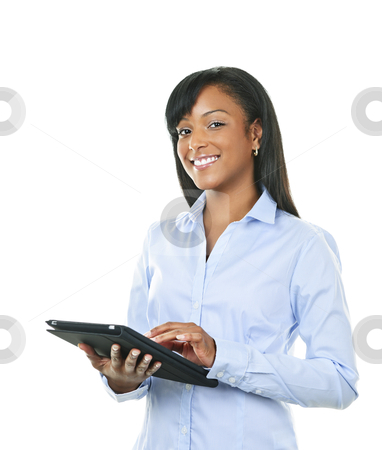 Happy woman with tablet computer stock photo, Young smiling black woman using tablet computer by Elena Elisseeva