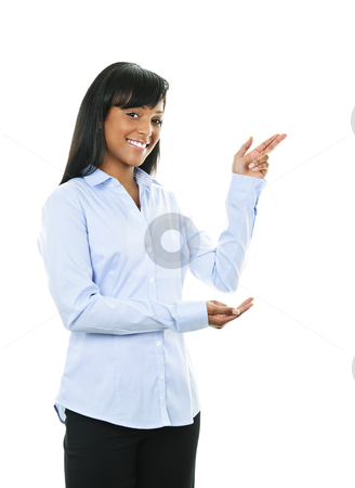 Smiling young woman pointing stock photo, Smiling black woman pointing to the side isolated on white background by Elena Elisseeva