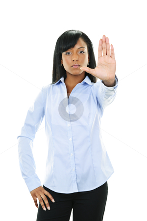 Serious young woman giving stop gesture stock photo, Serious black woman showing stop hand gesture isolated on white background by Elena Elisseeva