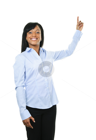 Smiling young woman pointing up stock photo, Smiling black woman pointing up isolated on white background by Elena Elisseeva