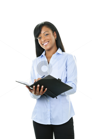 Smiling woman with leather portfolio folder stock photo, Young smiling  black woman writing in leather portfolio folder by Elena Elisseeva