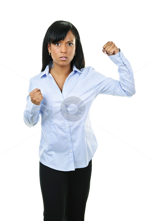 Young woman ready to fight stock photo, Fighting black woman showing fists isolated on white background by Elena Elisseeva