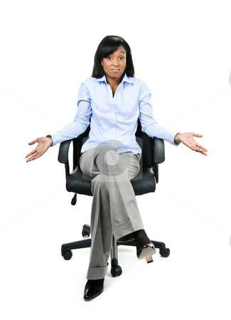 Shrugging businesswoman in office chair stock photo, Young shrugging confused black businesswoman sitting in leather office chair by Elena Elisseeva