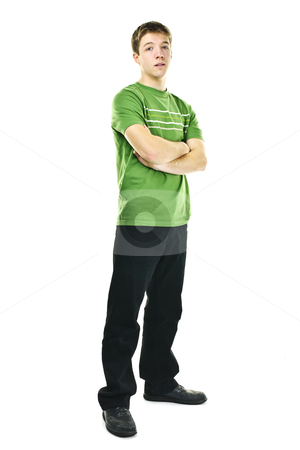 Young man with crossed arms stock photo, Serious young man standing full body with arms crossed isolated on white background by Elena Elisseeva