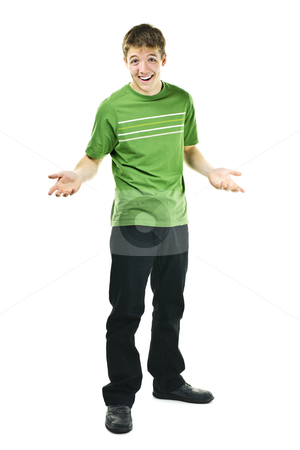 Smiling young man shrugging stock photo, Shrugging smiling young man standing isolated on white background by Elena Elisseeva