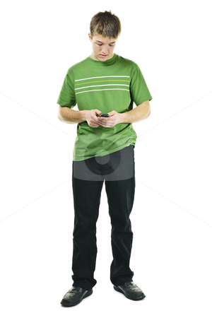 Young man texting on cell phone stock photo, Young man texting on cellphone standing full body isolated on white background by Elena Elisseeva