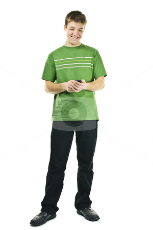 Smiling young man texting on mobile phone stock photo, Happy young man texting on cellphone standing full body isolated on white background by Elena Elisseeva