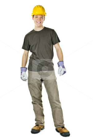 Young construction worker smiling stock photo, Young construction worker with hard hat full body standing isolated on white background by Elena Elisseeva
