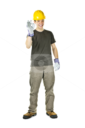 Happy construction worker stock photo, Smiling construction worker showing okay sign standing isolated on white background by Elena Elisseeva