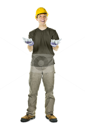 Smiling construction worker looking up stock photo, Young construction worker looking up shrugging isolated on white background by Elena Elisseeva