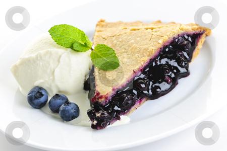 Blueberry pie slice stock photo, Slice of blueberry pie with vanilla ice cream and berries by Elena Elisseeva