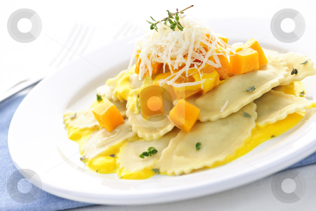 Ravioli dinner stock photo, Gourmet squash ravioli dinner served with cheese on plate by Elena Elisseeva