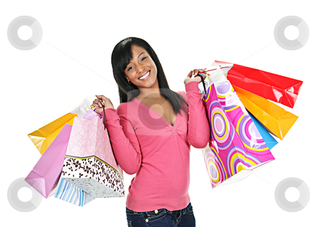 Happy young black woman with shopping bags stock photo, Young smiling black woman holding colorful shopping bags by Elena Elisseeva