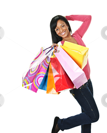 Young excited black woman with shopping bags stock photo, Young excited smiling black woman holding shopping bags by Elena Elisseeva