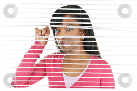 Woman looking through venetian blinds stock photo, Young black woman looking through horizontal venetian blinds by Elena Elisseeva