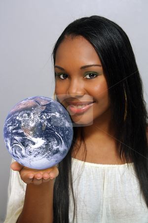 Beautiful Haitian Girl, Headshot (4) stock photo, A close-up of a lovely young Haitian girl with a captivating smile, holding a miniature earth in the palm of her hand. by Carl Stewart
