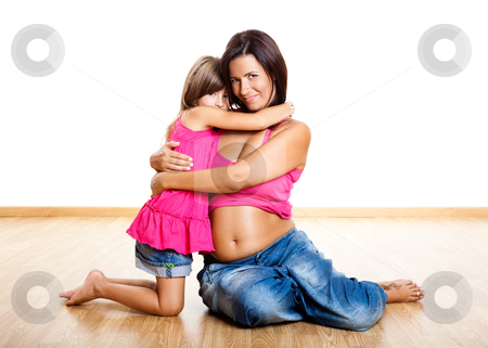 Pregnant woman with her daughter stock photo, Beautiful pregnant mother with her daughter isolated on white  by ikostudio