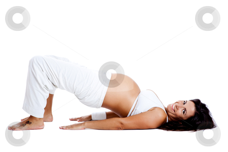 Pregnancy exercises stock photo, Pregnant woman making fitness exercises, isolated on white by ikostudio