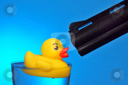 Duck Hunting. stock photo, Rubber ducky under the nose of a big gun. by WScott