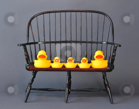 Rubber Ducky Family stock photo, Family of rubber ducks setting in a chair. by WScott