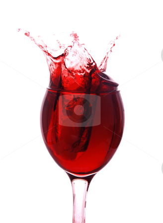 Red wine splashing out  stock photo, Red wine splashing out of a glass  by bakelyt