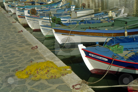 Greek Fishing Boats stock photo, A Line of small Greek Fishing Boats on the quayside at Elounda Crete by d40xboy