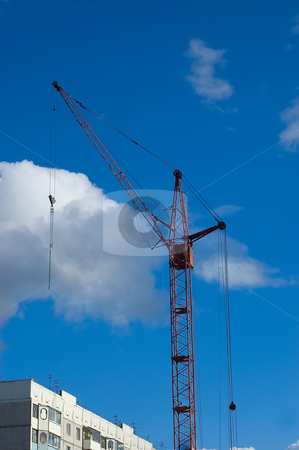 Tower crane stock photo, Tower crane at housing construction site by olinchuk