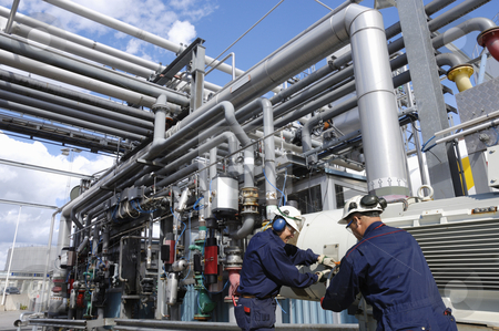 Chemical engineers and oil industry stock photo, two engineers inside oil and gas industry, working at main pipeline fuel station by lagereek