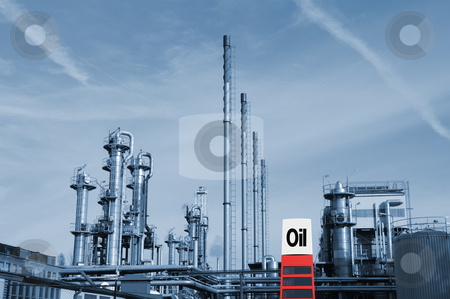 Oil and gas industry installation stock photo, large oil, gas and fuel industry with information oil-sign in foreground, no trademarks issues by lagereek