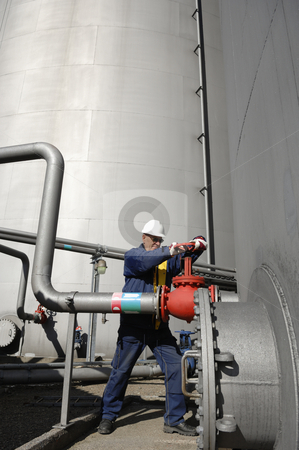 Oil worker, engineer and fuel storage stock photo, engineer, oil-worker, inside oil-refinery, working with pumps on fuel-storage tanks by lagereek