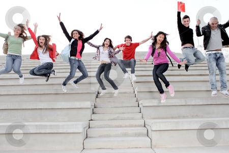 Happy university or high school children happy at end of term stock photo, Happy university or high school children happy at end of term,diverse,diversity,campus,american,caucassian,spanish,asian,mixed,race,multi,books,jumping shouting,smiling,class,campus, by mandygodbehear