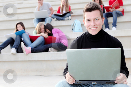 Boy university student with laptop or notebook stock photo, Boy university student with laptop or notebook by mandygodbehear