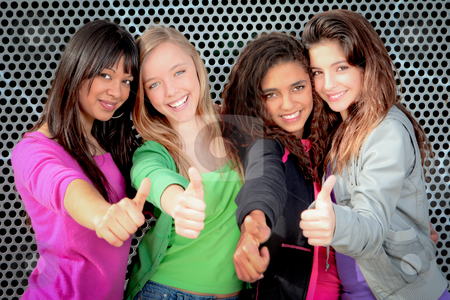 Happy diverse teen girls showing thumbs up stock photo, Happy diverse teen girls showing thumbs up by mandygodbehear