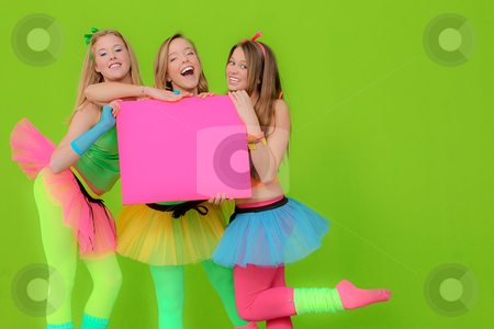 Fashion girls in neon clothing holding blank pink billboard stock photo, Fashion girls in neon clothing holding blank pink billboard by mandygodbehear